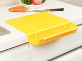 Folding cutting board with container