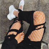 Long fishnet mesh stockings