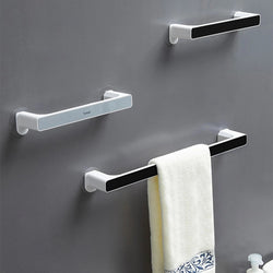 Self-adhesive towel holder