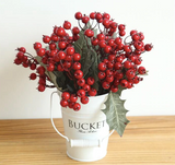 Red berries bouquet home decoration