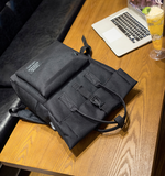 Folded top USB backpack