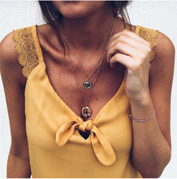 V-neck bow lace top