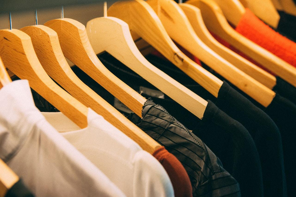 t-shirts hanging in a row