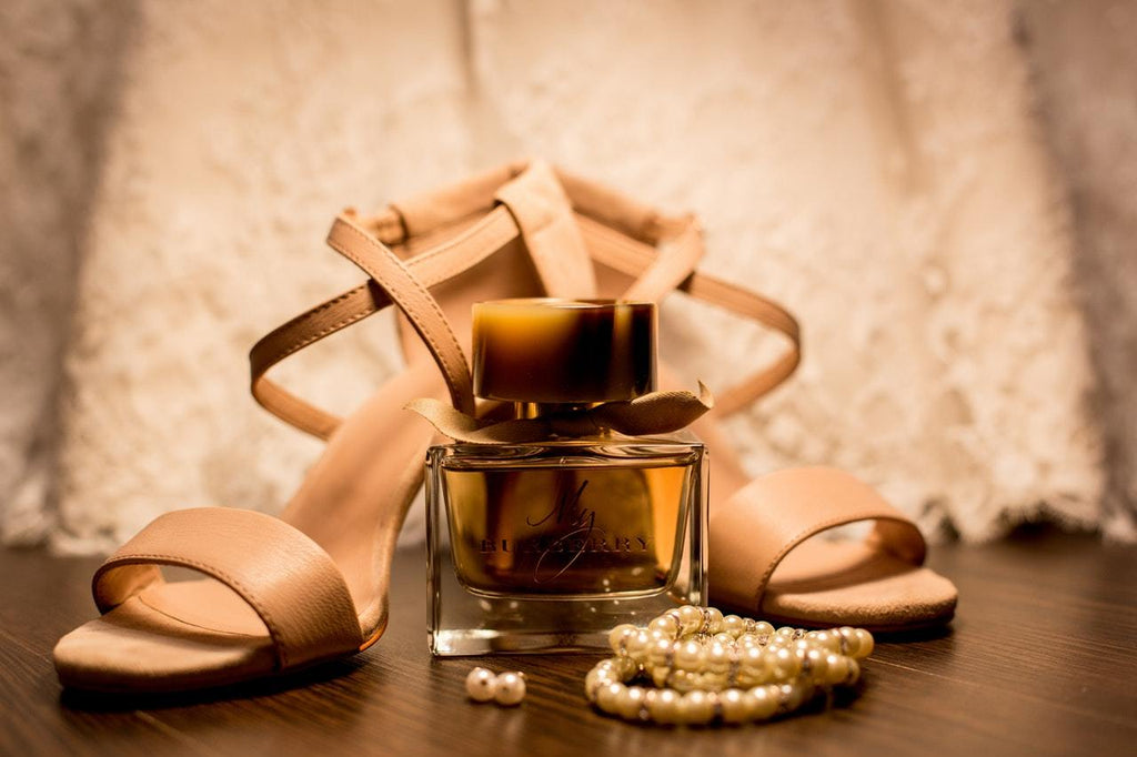 a pair of sandal and perfume