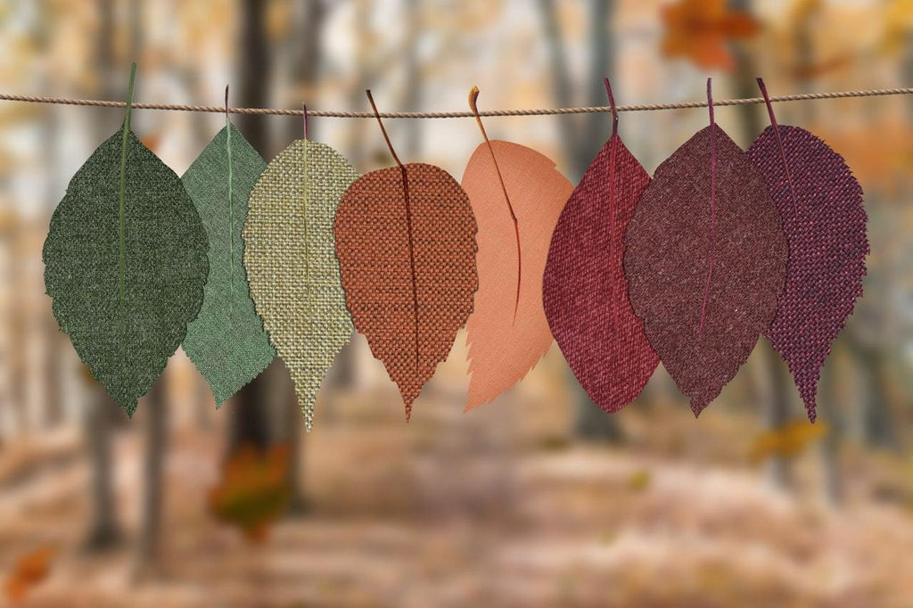 leaves of different shades hanging on a rope