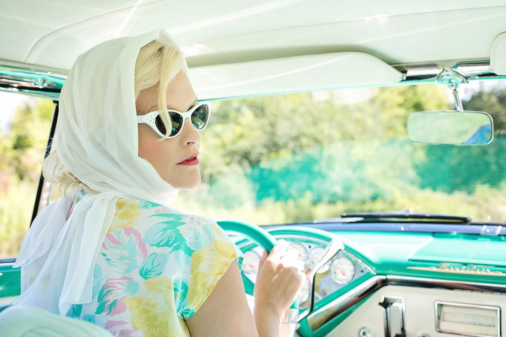 woman driving a vintage car