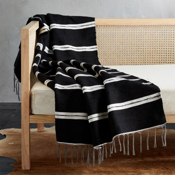 how to style a moroccan throw blanket on a bench