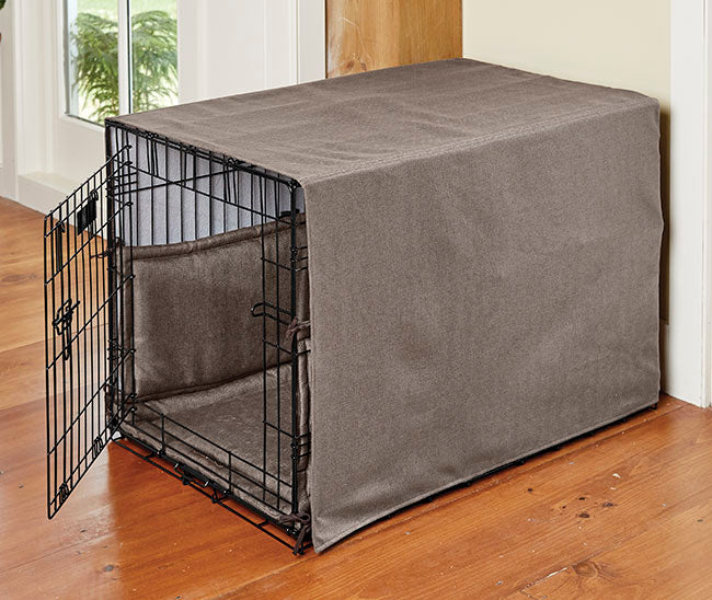 dog crate with blanket on top