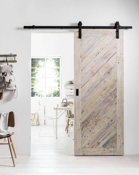 whitewashed wood barn door in the house