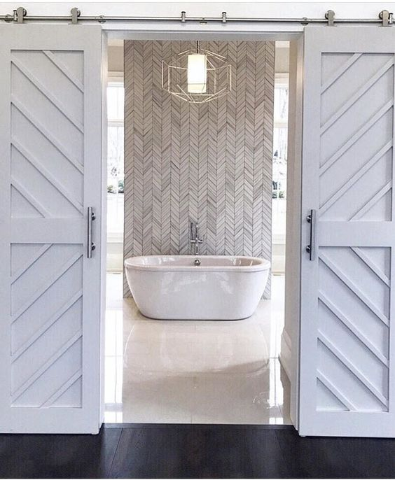 double barn doors leading to bathroom