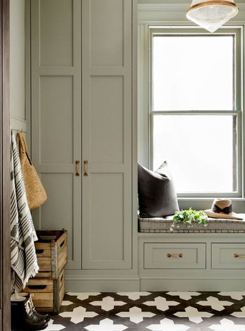 sage cabinetry in farmhouse home