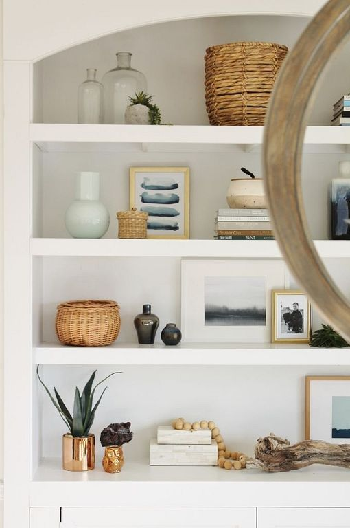 layering items for decorating a shelf