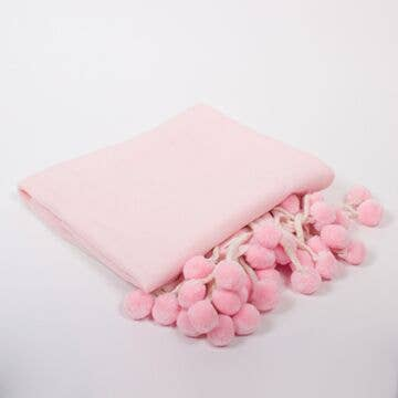 Pink lightweight pom pom throw