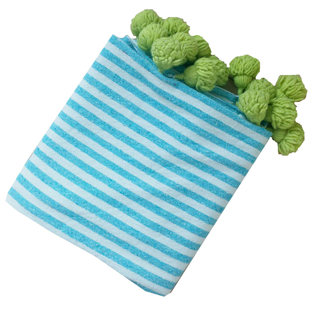 Turquoise and lime pom pom throw