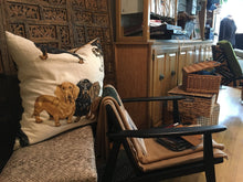 wiener dog Dachshund pillow shown in Miller Upholstering shop near chair for scale