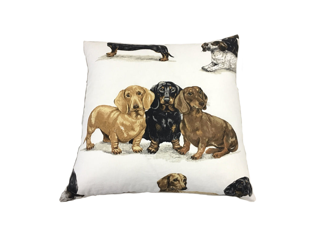 large white linen pillow with realistically printed black, tan and brown dachshund wiener dogs