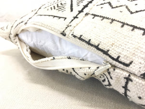 white with black tribal printing mali cloth pillow open at zippered edge to see professional sewing and finish