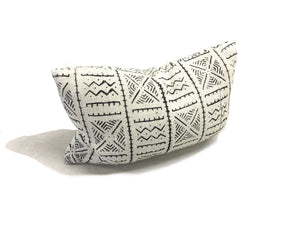 white with black tribal printing Mali cloth pillow standing on it's zippered bottom