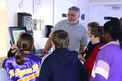 Dr. Mac Instructing a Student Group