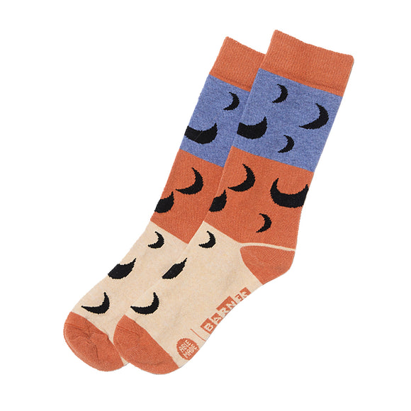 pair of socks featuring modern moon pattern inspired by Miro