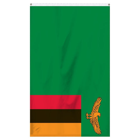 Zambia National flag for sale to buy online from Atlantic Flag and Pole, an American company. A green field with an orange coloured eagle in flight over a rectangular block of three vertical stripes colored from left to right in red, black and orange.