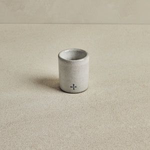 Grey ceramic mini espresso cup, on beige background