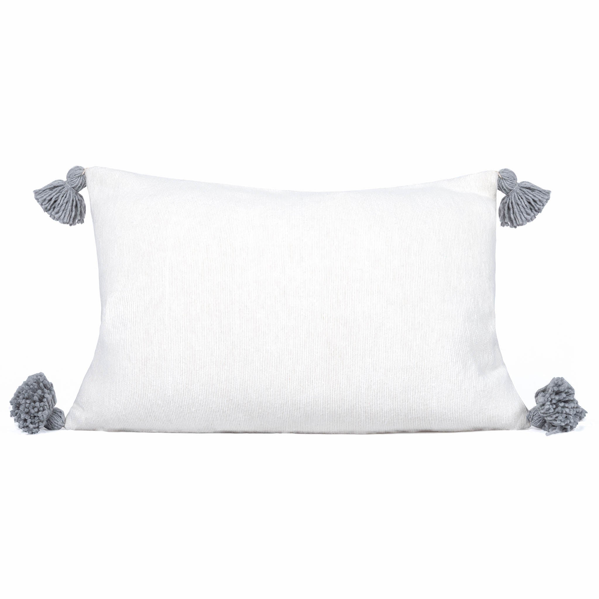Solid white rectangled cushion with tassels