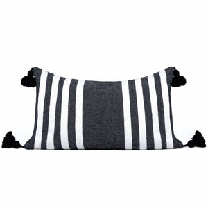 Black and white striped cushion with tassels