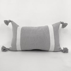 Gray rectangular cushion with pompoms with a simple line on each side