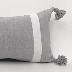 Rectangular grey cushion to be pumped with a white line from each side