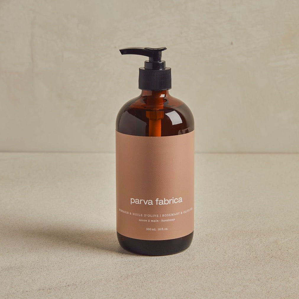 Handsoap bottle with pump with beige label on beige background