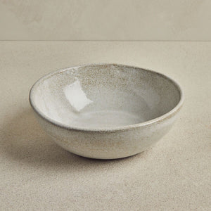 Grey bowl on a beige background