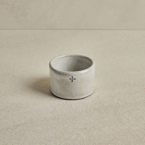 Light Gray Ceramic Ramekin on a beige background