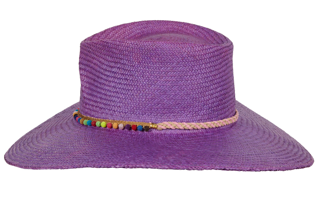 Anja. Purple panama straw hat with multi colored pom-poms and suede band.