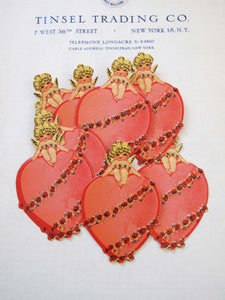 Cherub Sitting on Heart Scrap 12 Pcs
