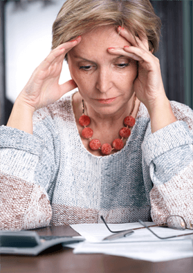 Woman suffering from chronic stress related symptoms