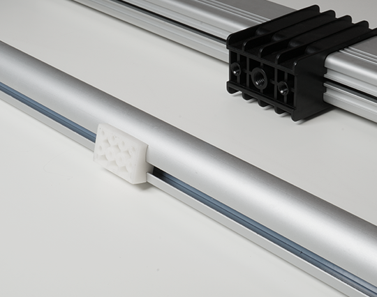 Track linear actuators are rodless