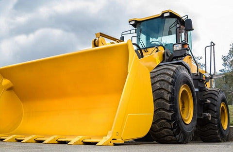 Photo of a wheel loader isolated on white background