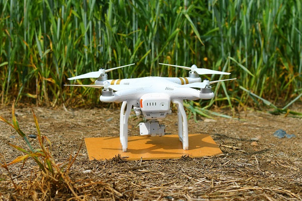 Drone quadcopter DJI Phantom 4 with high-resolution digital camera and front obstacle sensors