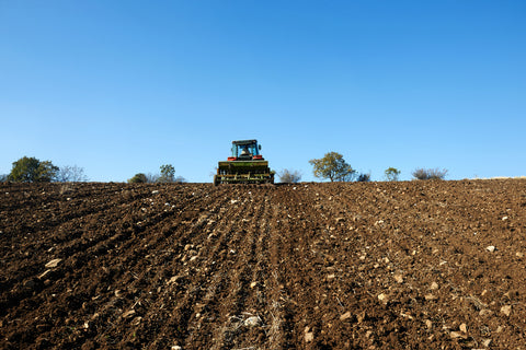 Photo of a tractor working in the field
