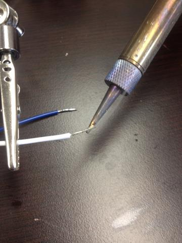 Photo of solder of tin ends to prevent fraying