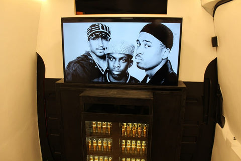 Photo of three men on the TV screen