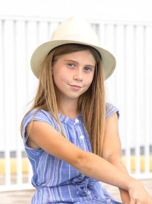 cute girl wearing a white hat. Fedora, Panama hat for kids