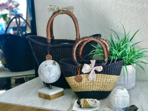 woven black basket in medium and black basket with natural straw that is very small. a Mini basket.