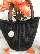 luxury medium black woven straw basket with leather handles and organge flowers