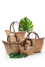 hand woven basket with leather handle made in ghana that are fair trade and sustainable straw.