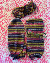 Pink, blue and green striped hand knit socks, almost finished.