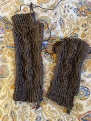 two brown Abington Mitts with cabling, almost finished