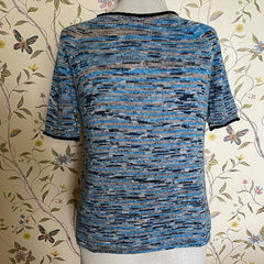 Variegated blue and gray short sleeved sweater with some pooling on the left breast.