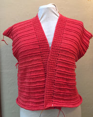 Coral colored hand knit, body almost done, needs sleeves.